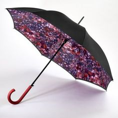 This is an elegant, stunning, and beautiful umbrella.  This umbrella has a double canopy - which means a top and a bottom cover which covers the ribs of the umbrella.  The outer canopy is black and the inner canopy is mix of colours including reds and blues.  This fabulous umbrella also has an automatic opening mechanism.