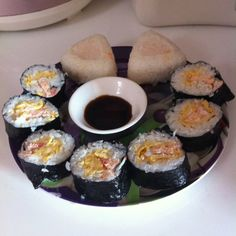 Self-made sushi roll    Ingredients:  - Cooked Rice with Sushi Vinegar  - Cooked Salmon  - Cooked Tuna Fish  - Egg  - Cucumber &   - Laver