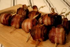 Bacon wrapped dates are filled with crunchy almonds and blue cheese.