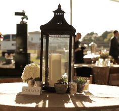Mix & match objects on a table for variety in table decor for a shabby chic or elegant country wedding reception.