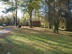 Fixer Upper. Great Split Level Floor Plan This 5 Ac. Parcel Sits Adjacent To Mls # 5199569 (16ac) For An Assembledge Total Of 21 Acres. Close To Fulton Co., Milton, Alpharetta, Woodstock But With Cherokee Co. Taxes.