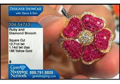 Flower pin of rubies and diamonds. If you love invisibly set stones you will love this ruby brooch. The rubies are brilliant red offset beautifully by diamonds set in yellow gold.