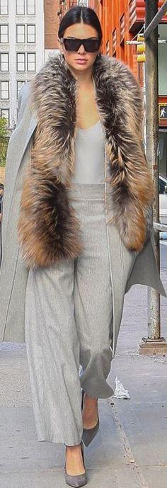 Kendall Jenner: Pants and coat – Sally LaPointe Shoes – Saint Laurent Sunglasses – Celine