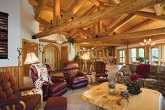 The great room in the Zientek hybrid residence features comfy leather recliners and massive trusses