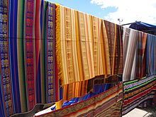 A textile or cloth is a flexible woven material consisting of a network of natural or artificial fibres often referred to as thread or yarn. Yarn is produced by spinning raw fibres of wool, flax, cotton, or other material to produce long strands. Textiles are formed by weaving, knitting, crocheting, knotting, or pressing fibres together.