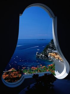 Window looking out from Hotel Punta Regina, Positano, Italy.  Beautiful window with a stunning view.