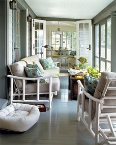 A Connecticut cottage porch with a painted floor designed by Schafer.