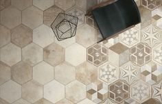 Rockwell by FINE is available in 16x14 hexagon field tile with coordinating 16x14 mixed deco.