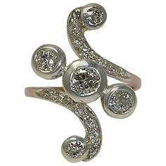 Fantastic Victorian 1.72 Carat Diamond Gold Platinum Swirl Ring | From a unique collection of vintage cocktail rings at https://www.1stdibs.com/jewelry/rings/cocktail-rings/