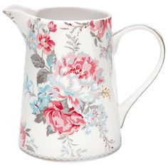 Add a charming touch to your afternoon tea set with this stoneware china milk jug, featuring a floral design.