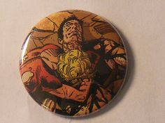 """Comic Book 1.5"""" Button// Wonder Girl crying over dead body Superboy, $1.00"""
