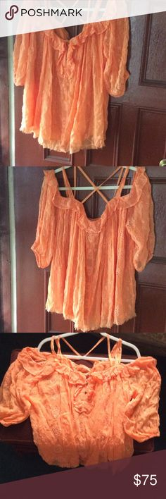 Anthropologie top Stunning orange eyelet top with ruffles around shoulder . Can wear on or off the shoulder. 100% Lyocell, like a polyester can be machine washed, 100%polyester lining. Label size (M) not true to size can fit a Liszt (L) since it is loose fitting. NWOT Anthropologie Tops Blouses