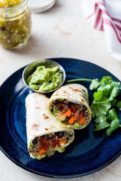 Mexican quinoa and black bean wraps with green chili guacamole.