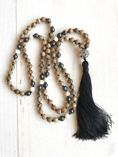 Nourish the soul and achieve inner bliss with this fragrant Agarwood Mala necklace from True Nature Jewelry. Custom designed in the spirit of Mother Nature, its features Agarwood beads accented with Howlite and Hematite beads. A decorative metal Guru bead and silky tassel complete