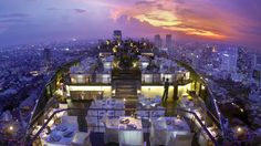 Vertigo and Moon Bar  Vertigo and Moon Bar is one of the highest al-fresco bars in the Asia Pacific, and a must-visit destination on every Bangkok travel itinerary. Located some 61 floors above the streets of Bangkok, at the top of the Banyan Tree Bangkok, this open-air rooftop lounge truly lives up to its name, offering views that simply take your breath away. There's no better place for a romantic rendezvous, lounging after work or a glamorous launch party.