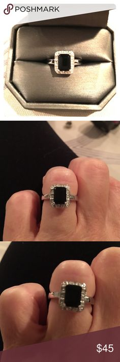 Sterling silver diamond and black onyx ring. Sterling silver diamond and black onyx ring size 7.  Worn one time and is in perfect condition. Jewelry Rings