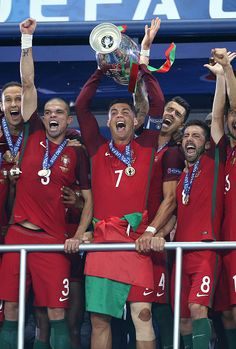 #EURO2016 Cristiano Ronaldo of Portugal celebrates the victory with teammates during the trophy ceremony following the UEFA Euro 2016 final match between...