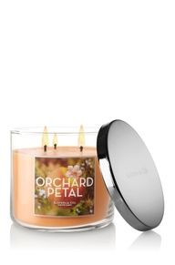 Orchard Petal 3-Wick Candle - Decorate any room in your home with the fragrance of dewy peony petals and pomegranate blended perfectly with sheer jasmine and fig.