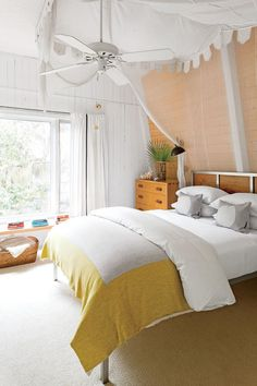 In no place is the home's boho beach style more well developed than in the living room, where Sherry freshened the interiors by painting everything, fire-place and a