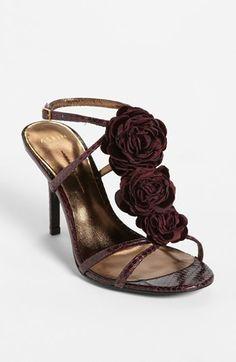 dark roses decorate a already pretty sandal