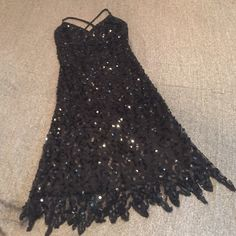 BETSEY JOHNSON EVENING Sequin overlay dress This stunning dress has it all!  Gorgeous sequin overlay that has an icicle hemline. No snags or sequins missing!! Also: adjustable spaghetti straps & invisible side zipper with hook and eye top closure. Betsey Johnson Dresses