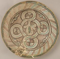 Dish Date: century Geography: Made in, Orvieto, Italy Culture: Italian Medium: Earthenware, tin-glaze (Majolica) Dimensions: Overall: 12 x 2 in. x cm) Classification: Ceramics Credit Line: Rogers Fund, 1916 Accession Number: Pottery Painting, Ceramic Painting, Ceramic Art, Painted Pottery, Italian Tiles, Italian Pottery, Pottery Designs, Medieval Art, Pottery Bowls