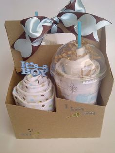 I just love this idea! Iced coffee & cupcake receiving blankets. Wrapped in coordinating scrapbook paper & arranged in a coffee carrier for easy gift giving! Perfect gift for any Starbucks addict.   4 receiving blankets  *2 Pampers diapers  *2 disposable coffee cups  *drink carrier