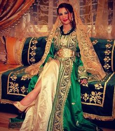 Traditionally, the bride dresses in green for the henna ceremony. This is a nice example of a green and gold gown that could be worn for that.