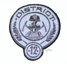 Hunger Games District 12 Iron On Embroidery Patch MTCoffinz. $8.00, via Etsy.