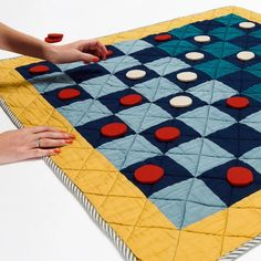 Roll out the quilted version of one of the oldest board games in existence. Novices and experts alike can play this classic, and then roll up the quilted board when the game is finished. Old Board Games, Felt Games, Classic Board Games, Machine Quilting Designs, Sustainable Gifts, Living Room Flooring, Game Pieces, Custom Embroidery, Haptic Lab