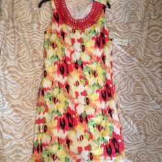 Beautiful NWT dress Beautiful colorful summer dress. Has side zipper and is lined. Size 10, hits right at knee on me. I'm 5'3. Kim Rogers Dresses Midi