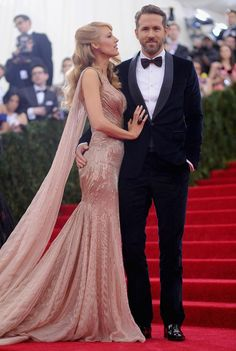 Blake Lively and Ryan Reynolds, both in Gucci, at the 2014 Met Gala. Notice where his hand is ... :)