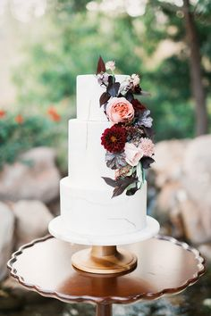 Burgundy and peach flowers on three tier wedding cake | fabmood.com #weddingtheme #bluewedding #weddinginspiration #weddingstyledshoot #weddingdesign