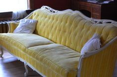 Vintage yellow tufted couch.