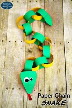 """""""This super silly Paper Chain Snake is an easy animal craft for young children to make. Cutting the paper, stapling the ends together, and connecting the loops to create the chain is a fun way for children to develop their fine motor skills."""""""
