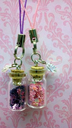 Tiny Bottle Cell Charm (Pink or Purple). $7.50, via Etsy.