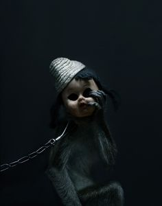 """""""A Kind of You"""" is a photo series by Finnish photographer Perttu Saksa, that features a chained up monkey wearing scummy dirty clothes and creepy doll masks. Taken in Indonesia."""