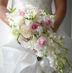 Teardrop style bouquet of orchids, roses, ranunculus and stephanotis #terrikrisavage #connecticutbridalflowers