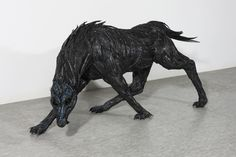 dog with arrows sculpture   Click an image & Use keyboard arrows to toggle to next image.