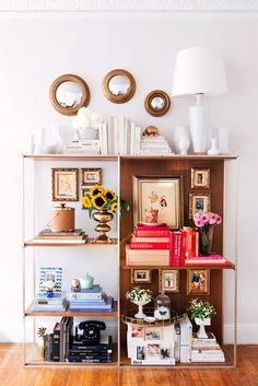 Pack most of your books (you're moving, right?) and try this artful colorblock display gathered from your own rooms. I would forgo the little mirrors, too small.