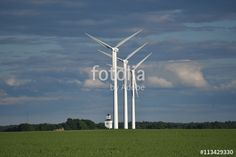 """Download the royalty-free photo """"aerogenerator windmills with a church, Ostergotland, Sweden"""" created by Ciaobucarest at the lowest price on Fotolia.com. Browse our cheap image bank online to find the perfect stock photo for your marketing projects!"""