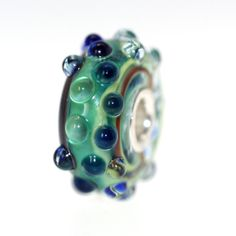See the bead you will get if you buy it!  Trollbeads Gallery - White Cap:With a Twist 85, $31.00 (http://www.trollbeadsgallery.com/white-cap-with-a-twist-85/)