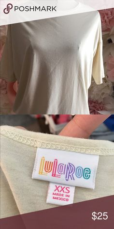 LuLaRoe Irma XXS Solid cream colored Irma. No stains and in great condition. LuLaRoe Tops Tunics
