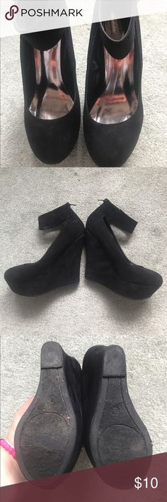 Women's Black Suede Heals Women's Black Suede Wedge Heals. They have an ankle strap. The shoes are in great contains with little wear to the Heals. Breckelle's Shoes Wedges