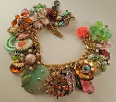 Such an interesting combination: Pink Nouveau Repurposed Vintage Jewelry Charm Bracelet one of a kind