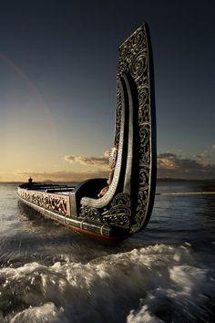 Canoeing via a Maori Waka (Traditional war canoe), New Zealand