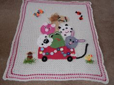 Crocheted child's afghan: Red wagon with lamb, pig, frog, horse, cow, and bunny by Ruth Harlock Hunter (from Facebook link: https://www.facebook.com/photo.php?fbid=10151511203200004=o.208886879213978)