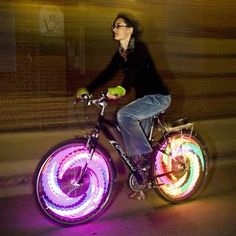 "Bike Wheel Lights ""Along with providing safety, they also look incredible with 32 full color LED lights that easily install into your existing bike's wheels."""