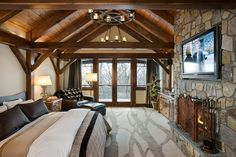 Timber frame bedroom with fireplace, patio, and check out that carpet!