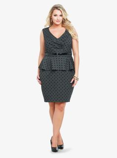 Black flocked polka dots spot this amazing grey dress. For a flattering fit, we added gathered accents to the surplice bodice and a pop of peplum to the sexy silhouette. Includes black vinyl skinny belt.